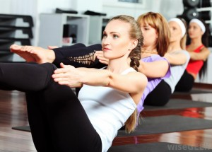 women-in-exercise-class-on-mats